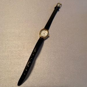 Timex gold watch with black wristband
